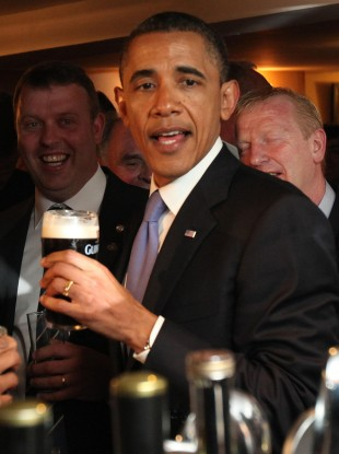 Obama enjoying a pint of Guinness in Moneygall in May 2011