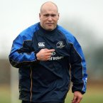 Strauss gets a loosening jog in before scrum practice (©INPHO/Donall Farmer).