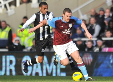 Dunne: in action against Newcastle last season.