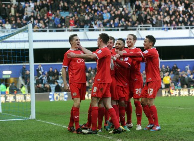 The MK Dons player celebrate with goalscorer Darren Potter.