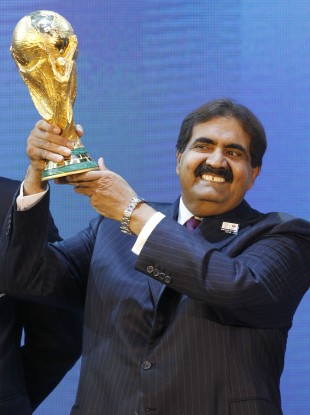Sheikh Hamad bin Khalifa Al-Thani, Emir of Qatar, holds the World Cup trophy after the announcement of Qatar hosting the 2022 tournament.