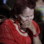 A woman reacts as people gather to pray for Venezuela's President Hugo Chavez at a church in Caracas, Venezuela. (AP Photo/Ariana Cubillos)