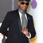Ne-Yo is never seen without a hat, seriously, google image him and you'll see.  Then google image