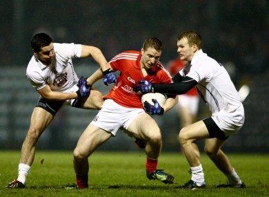 Cork's Colm O'Neill in action against Mikey Conway and Peter Kelly, of Kildare.