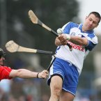 Waterford's Dan Shanahan is blocked by Wayne Sherlock of Cork, in 2007, who breaks his hurl in the process (©INPHO/Cathal Noonan)