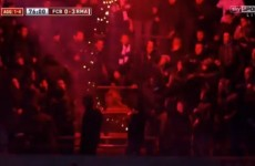 VIDEO: Real Madrid fans throw flare at Barcelona supporters