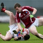 Louth's Gerard Hoey and Ger Egan of Westmeath. Pic: INPHO/James Crombie