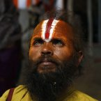 A Hindu holy man pauses as he returns after taking part in a community feast at the Ashram of Swami Ramanand Das at Sangam, the confluence of the Rivers Ganges and Yamuna during the Maha Kumbh festival, in Allahabad, India, Wednesday, Feb. 20, 2013. Millions of Hindu pilgrims have been attending the Maha Kumbh festival, which is one of the world's largest religious gatherings that lasts 55 days and falls every 12 years. (AP Photo/ Rajesh Kumar Singh)
