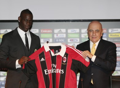 Balotelli with AC Milan vice president Adriano Galliani.