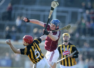 Galway's Jonathan Glynn with Kilkenny's Tommy Walsh.
