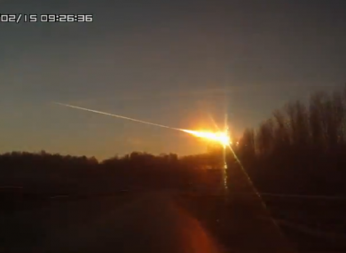 A video taken from a moving car captures a meteor landing in the Russian Urals