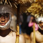 Nepalese Hindu devotees carry water-soaked hay on their heads during Madhav Narayan Festival in Lalitpur, on the outskirts of Katmandu, Nepal, Friday, February 22, 2013. Devotees representing Hindu God Madhav Narayan travel through town sprinkling holy water as blessings during the month-long Festival for a prosperous life. (AP Photo/Niranjan Shrestha)