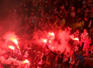 Flares at last night's game regularly had to be extinguished by members of security.