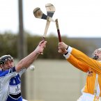 Seamus Dwyer of Laois clashes with Brendan Herron of Antrim in 2009. (©INPHO/Donall Farmer)