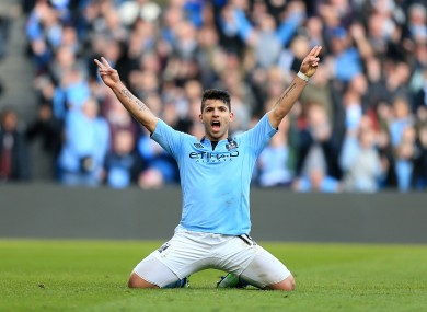 Kun: Aguero celebrates scoring his side's fourth.