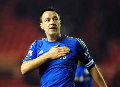 Chelsea's John Terry puts his hand on the club badge as he celebrates his side's victory.