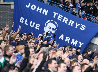 Chelsea fans show their support at Stamford Bridge today.