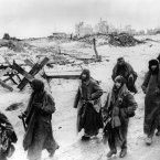 Stalingrad fell on January 31, 1943 to the Soviet armies and brought to end the major German resistance in that city. It was seen by many as a turning point on World War II. Photo shows captured German soldiers, their uniforms tattered from the battle, making their way in the bitter cold through the ruins of Stalingrad.
