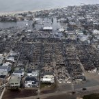 Aerial photo shows burned-out homes in the Breezy Point section of the Queens borough New York after a fire. (AP Photo/Mike Groll, File)