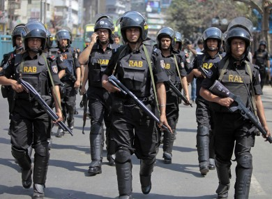 Bangladeshi security personnel patrol in front of Baitul Mukarram mosque in Dhaka, Bangladesh.