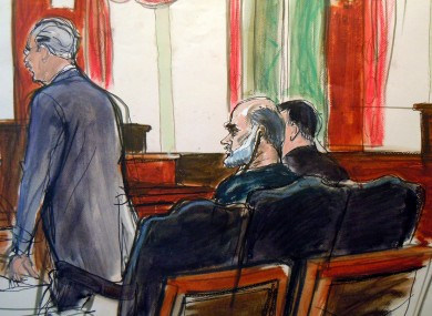 In this courtroom sketch, Osama bin Laden's son-in-law, Sulaiman Abu Ghaith, center, listens as court-appointed federal defender Philip Weinstein, left, speaks in U.S. Federal court Friday, March 8, 2013.