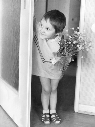 If we were all this cute, it wouldn't matter what we gave - even picked flowers from the garden. Image: Germany, May 1966