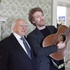 President Higgins stands with Oscar-winning songwriter Glen Hansard in ras an Uachtarin at the filming of 'Glaoch - The President's Call'.