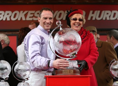 Paul Carberry (left) celebrates winning the Ladbrokes World Hurdle on Solwhit.