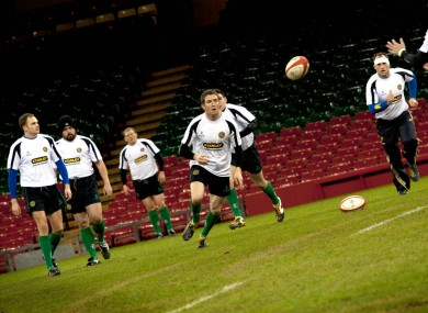 Paddy O'Toole passes to John Moore during the Ireland Police Rugby Team's training session