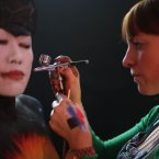 Model Laney Yau is painted by artist Orlagh Gilsenan during the All-Ireland Body Painting Championships in Temple Bar. (Niall Carson/PA Wire)