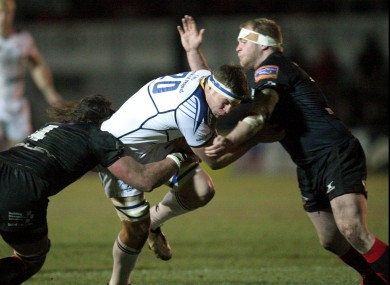 Leinster's Jordi Murphy tackled by Dragons' Ian Nimmo and Aaron Coundley.