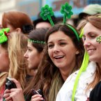 Revellers watch the St Patrick's day parade and festival in Trafalgar Square, London.