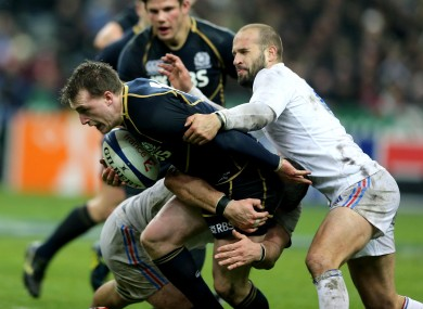 Stuart Hogg is grabbed by Freddy Michalak.