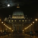The fool moon is seen above the St. Peter's Basilica at the Vatican, early Tuesday, Feb. 26, 2013. Pope Benedict XVI has changed the rules of the conclave that will elect his successor, allowing cardinals to move up the start date if all of them arrive in Rome before the usual 15-day transition between pontificates. Benedict signed a legal document, issued Monday, with some line-by-line changes to the 1996 Vatican law governing the election of a new pope. It is one of his last acts as pope before resigning Thursday. (AP Photo/Dmitry Lovetsky)