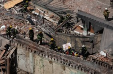 One dead, 13 hurt in US building collapse
